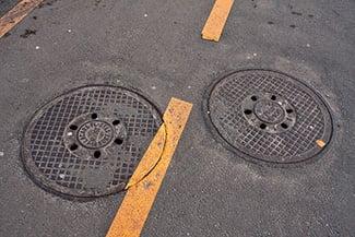 sewer drain or manhole needs repair