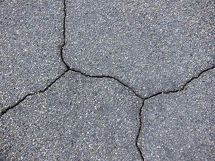 sealcoat and fill cracks in asphalt pavement