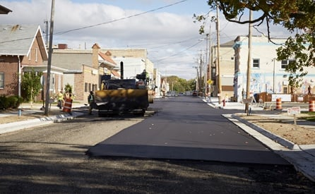 WOLF_blog_commercial-18_paving-truck-working-road.jpg